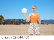 Купить «teenage girl with volleyball over venice beach», фото № 29044460, снято 30 июня 2018 г. (c) Syda Productions / Фотобанк Лори