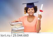 Купить «african graduate student with books and diploma», фото № 29044660, снято 8 июля 2015 г. (c) Syda Productions / Фотобанк Лори