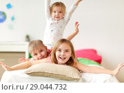 Купить «happy little kids having fun in bed at home», фото № 29044732, снято 15 октября 2017 г. (c) Syda Productions / Фотобанк Лори