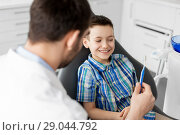 Купить «dentist giving toothbrush to kid patient at clinic», фото № 29044792, снято 22 апреля 2018 г. (c) Syda Productions / Фотобанк Лори