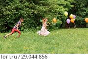 Купить «happy kids playing tag game at birthday party», фото № 29044856, снято 27 мая 2018 г. (c) Syda Productions / Фотобанк Лори