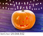Купить «close up of halloween pumpkin on table», фото № 29044932, снято 17 сентября 2014 г. (c) Syda Productions / Фотобанк Лори