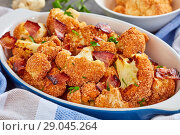 Купить «close-up of baked in oven Breaded cauliflower», фото № 29045264, снято 11 августа 2018 г. (c) Oksana Zh / Фотобанк Лори