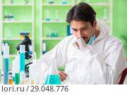 Купить «Chemist working in the lab on new experiment», фото № 29048776, снято 16 мая 2018 г. (c) Elnur / Фотобанк Лори