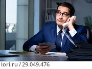 Купить «Young business playing cards late in office», фото № 29049476, снято 9 октября 2017 г. (c) Elnur / Фотобанк Лори