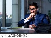 Купить «Young business playing cards late in office», фото № 29049480, снято 9 октября 2017 г. (c) Elnur / Фотобанк Лори