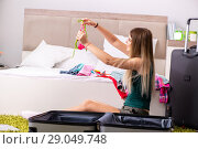 Купить «Young woman getting ready for summer vacation», фото № 29049748, снято 29 июня 2018 г. (c) Elnur / Фотобанк Лори