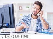 Купить «Frustrated young man due to weak internet reception», фото № 29049948, снято 6 июля 2017 г. (c) Elnur / Фотобанк Лори
