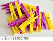 Купить «Hill from yellow and pink linen clothespins», фото № 29050796, снято 30 июля 2018 г. (c) Володина Ольга / Фотобанк Лори
