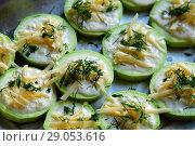 Купить «raw zucchini with cheese on baking sheet», фото № 29053616, снято 3 июля 2018 г. (c) Володина Ольга / Фотобанк Лори