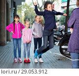 Купить «Joyful children play on street of summer city», фото № 29053912, снято 21 октября 2017 г. (c) Яков Филимонов / Фотобанк Лори