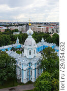 Купить «Saint Petersburg. View from the height of the bell tower of the Smolny Cathedral to the Church of Alexander Nevsky (1748), Smolny Garden and the city on a summer day», фото № 29054632, снято 2 сентября 2018 г. (c) Виктория Катьянова / Фотобанк Лори