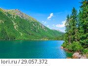 Купить «a picturesque clean mountain lake in the Tatras, a landmark of Poland - Morskie Oko», фото № 29057372, снято 18 августа 2017 г. (c) Константин Лабунский / Фотобанк Лори