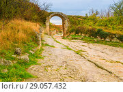 Купить «Arch - architectural artifact of the ancient cave city in Chufut-Kale, Crimea», фото № 29057432, снято 6 ноября 2017 г. (c) Константин Лабунский / Фотобанк Лори