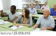 Купить «Group different ages asks questions during exam», видеоролик № 29058016, снято 23 июля 2018 г. (c) Яков Филимонов / Фотобанк Лори