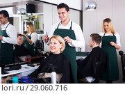 Купить «Professional stylist cutting hair of elderly blonde», фото № 29060716, снято 19 апреля 2019 г. (c) Яков Филимонов / Фотобанк Лори