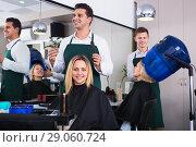 Купить «Positive young man cutting long hair of girl», фото № 29060724, снято 19 апреля 2019 г. (c) Яков Филимонов / Фотобанк Лори