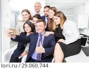 Купить «successful business colleagues making selfie», фото № 29060744, снято 21 апреля 2018 г. (c) Яков Филимонов / Фотобанк Лори