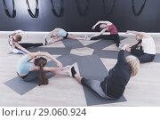 Купить «Women exercising yoga in circle in fitness center», фото № 29060924, снято 29 января 2018 г. (c) Яков Филимонов / Фотобанк Лори