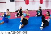 Купить «Women doing box exercises», фото № 29061008, снято 8 октября 2017 г. (c) Яков Филимонов / Фотобанк Лори