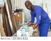 Young craftsman inspecting finished product. Стоковое фото, фотограф Яков Филимонов / Фотобанк Лори