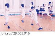 Купить «Mixed age group of athletes at fencing coach», фото № 29063916, снято 30 мая 2018 г. (c) Яков Филимонов / Фотобанк Лори