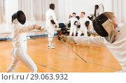 Купить «Modern group practicing fencing techniques», фото № 29063932, снято 30 мая 2018 г. (c) Яков Филимонов / Фотобанк Лори