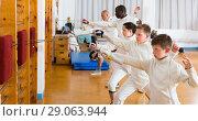 Купить «Happy group of athletes at fencing workout», фото № 29063944, снято 30 мая 2018 г. (c) Яков Филимонов / Фотобанк Лори