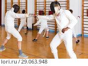 Купить «Young fencers training with coach», фото № 29063948, снято 30 мая 2018 г. (c) Яков Филимонов / Фотобанк Лори
