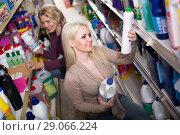 Купить «Women buying detergents», фото № 29066224, снято 17 июня 2019 г. (c) Яков Филимонов / Фотобанк Лори