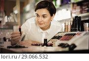 Купить «Female customer searching for reliable make-up products», фото № 29066532, снято 31 января 2017 г. (c) Яков Филимонов / Фотобанк Лори