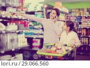 Купить «Woman with girl telephoning to consult about shopping», фото № 29066560, снято 5 января 2017 г. (c) Яков Филимонов / Фотобанк Лори