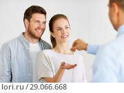 Купить «realtor giving keys from new home to happy couple», фото № 29066668, снято 4 июня 2017 г. (c) Syda Productions / Фотобанк Лори