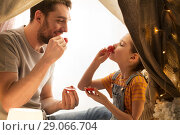 Купить «family playing tea party in kids tent at home», фото № 29066704, снято 27 января 2018 г. (c) Syda Productions / Фотобанк Лори