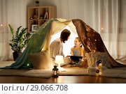 Купить «family with tablet pc in kids tent at home», фото № 29066708, снято 27 января 2018 г. (c) Syda Productions / Фотобанк Лори