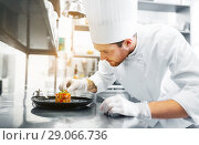 Купить «happy male chef cooking food at restaurant kitchen», фото № 29066736, снято 2 апреля 2017 г. (c) Syda Productions / Фотобанк Лори