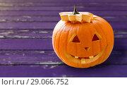 Купить «close up of halloween pumpkin on table», фото № 29066752, снято 17 сентября 2014 г. (c) Syda Productions / Фотобанк Лори