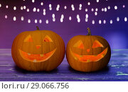 Купить «close up of halloween pumpkins on table», фото № 29066756, снято 17 сентября 2014 г. (c) Syda Productions / Фотобанк Лори