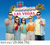 Купить «friends in sunglasses showing ok hand sign», фото № 29066792, снято 30 июня 2018 г. (c) Syda Productions / Фотобанк Лори