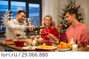 Купить «happy friends drinking red wine at christmas party», фото № 29066880, снято 17 декабря 2017 г. (c) Syda Productions / Фотобанк Лори