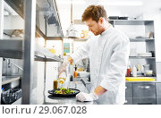 Купить «happy male chef cooking food at restaurant kitchen», фото № 29067028, снято 2 апреля 2017 г. (c) Syda Productions / Фотобанк Лори