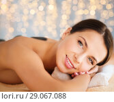 Купить «beautiful woman having hot stone therapy at spa», фото № 29067088, снято 25 июля 2013 г. (c) Syda Productions / Фотобанк Лори