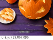 close up of halloween pumpkin on table. Стоковое фото, фотограф Syda Productions / Фотобанк Лори