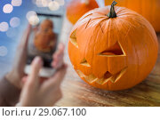 Купить «close up of jack-o-lantern or halloween pumpkin», фото № 29067100, снято 15 сентября 2017 г. (c) Syda Productions / Фотобанк Лори