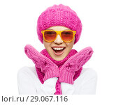 Купить «happy teenage girl in winter hat and sunglasses», фото № 29067116, снято 15 октября 2019 г. (c) Syda Productions / Фотобанк Лори