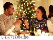 Купить «happy couple celebrating christmas at home feast», фото № 29067296, снято 17 декабря 2017 г. (c) Syda Productions / Фотобанк Лори