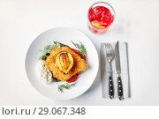Купить «fish salad and glass of drink on restaurant table», фото № 29067348, снято 16 января 2017 г. (c) Syda Productions / Фотобанк Лори