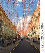 Moscow, Russia - Sep 9. 2018. Bolshaya Dmitrovka street after renovation decorated for City Day. Редакционное фото, фотограф Володина Ольга / Фотобанк Лори