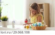 Купить «happy girl coloring easter eggs at home», видеоролик № 29068108, снято 10 августа 2018 г. (c) Syda Productions / Фотобанк Лори
