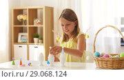 Купить «happy girl decorating easter eggs at home», видеоролик № 29068124, снято 10 августа 2018 г. (c) Syda Productions / Фотобанк Лори